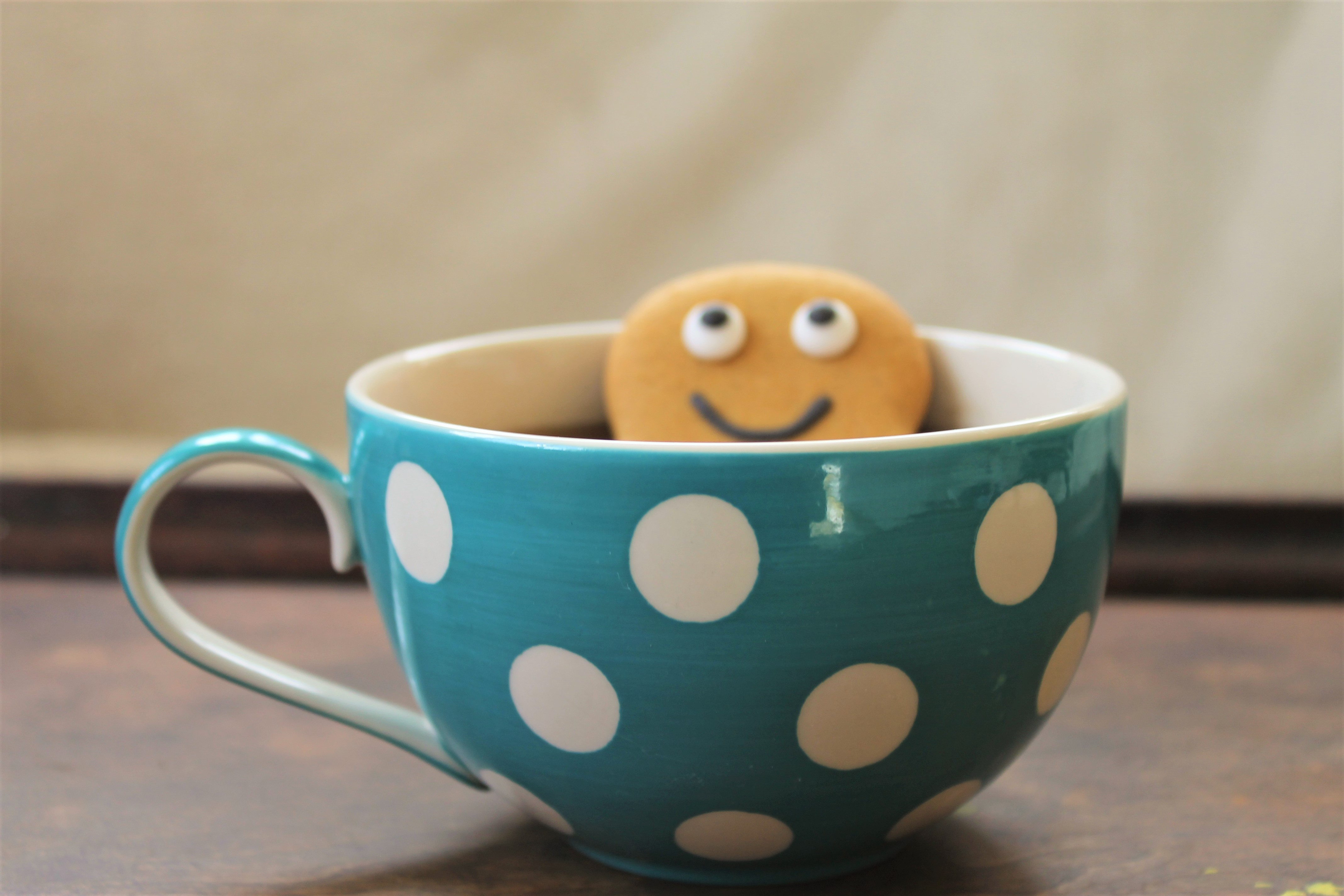 ginger bread man in a polka dot teacup