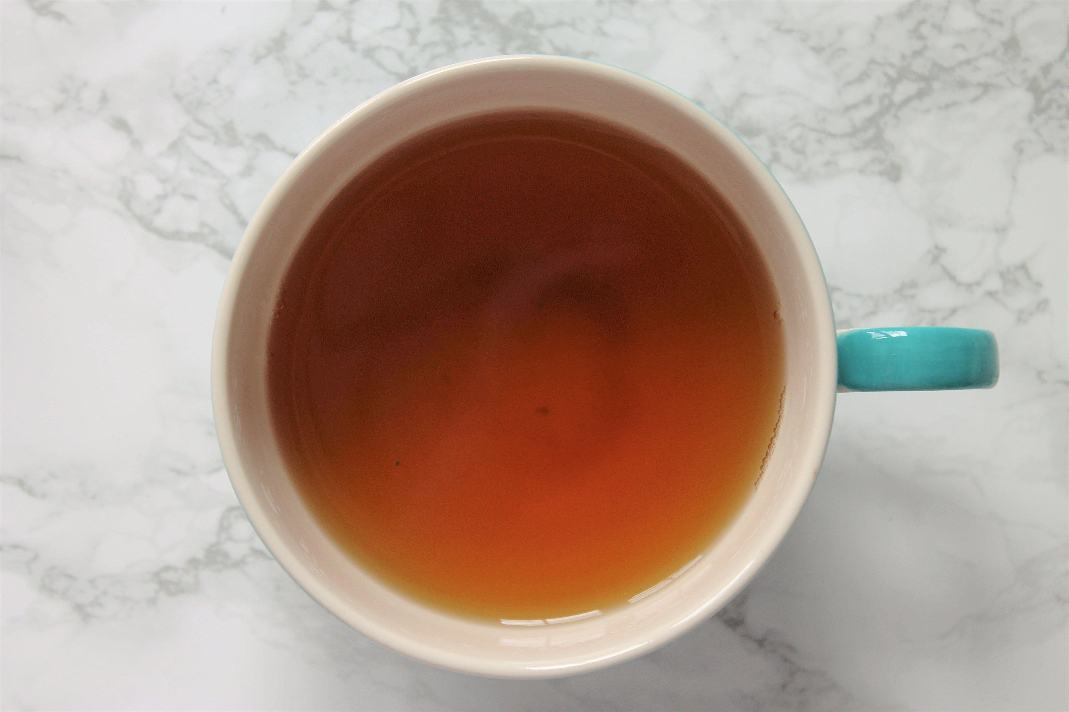 ginger peach tea in teacup