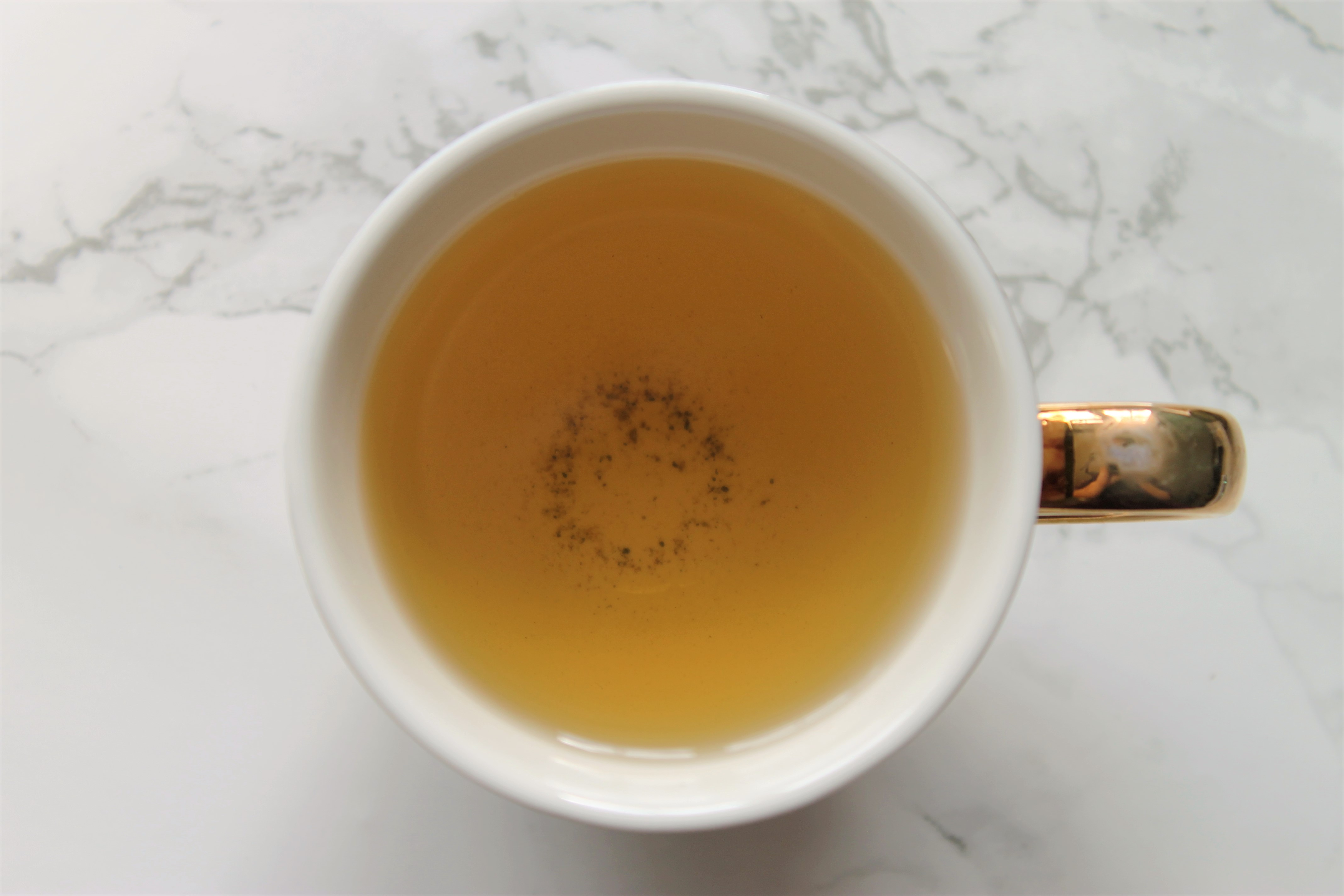 basilur white moon milk oolong in teacup