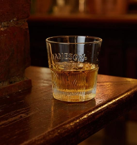 jameson irish whiskey in glass cup