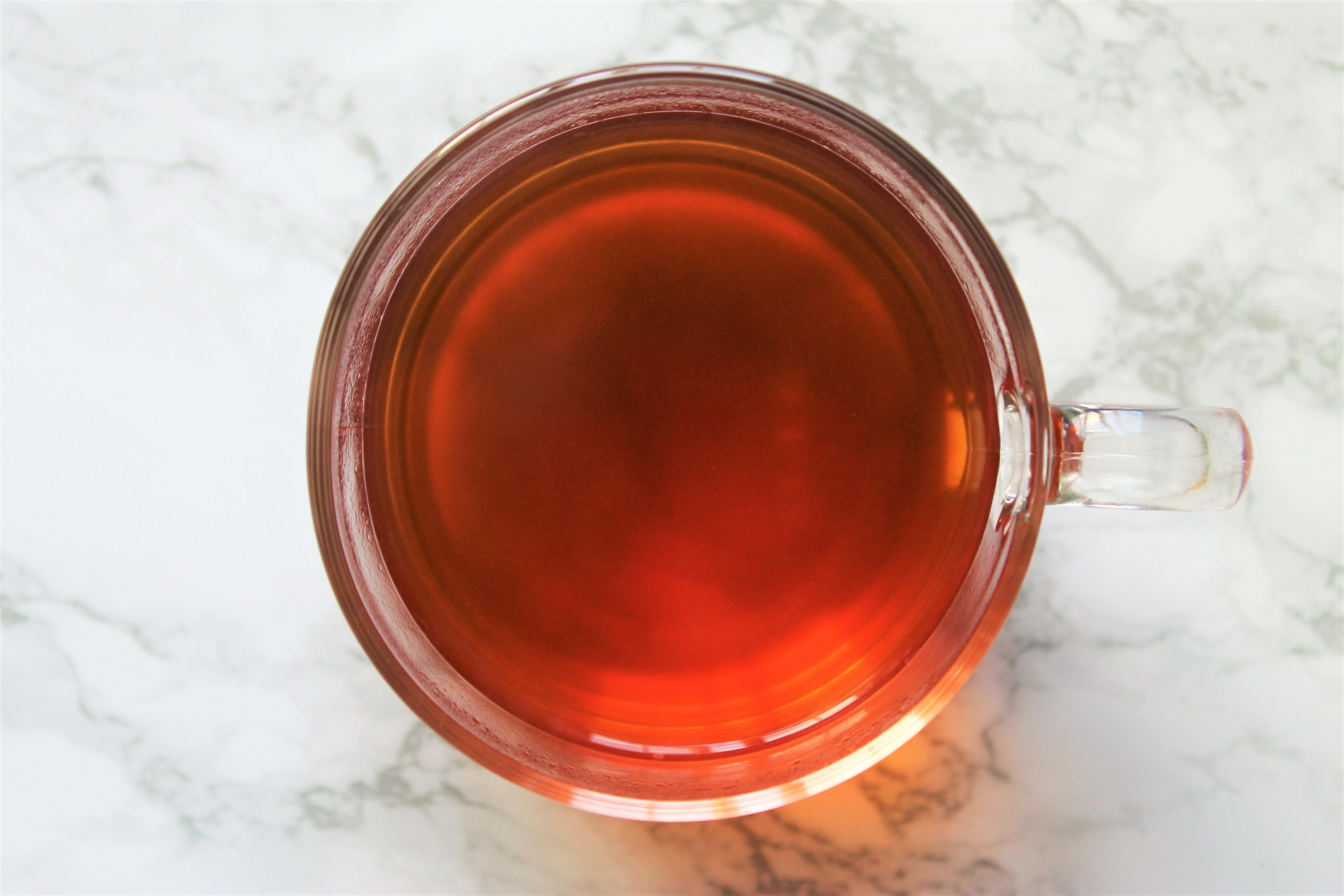 rooibos vanilla tea in glass teacup