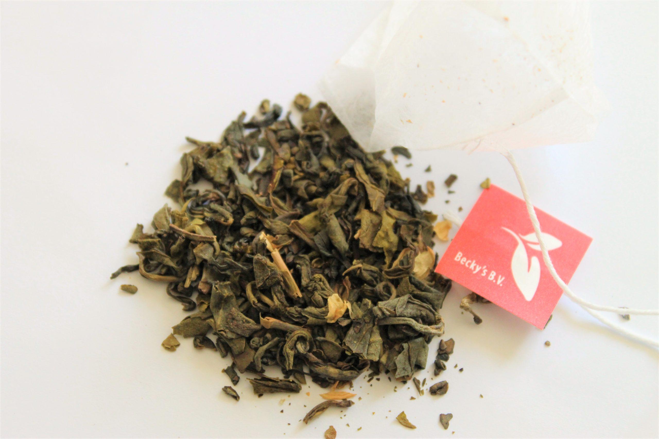 green tea leaves and jasmine petals