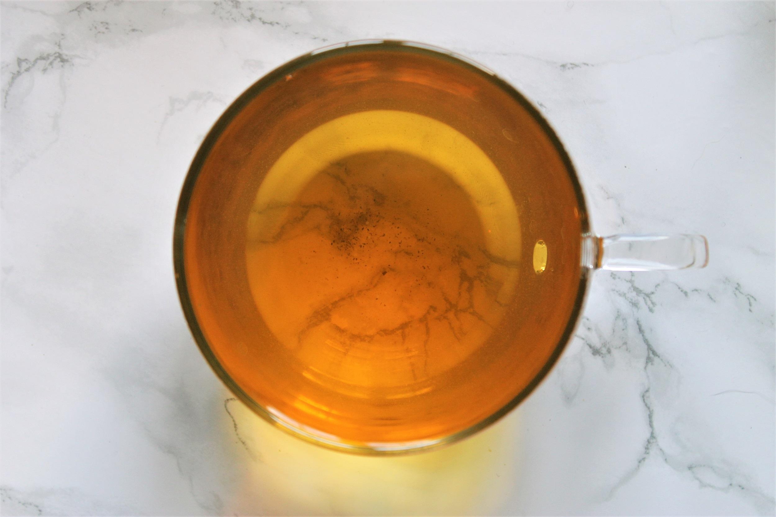 green tea with lemon glass teacup