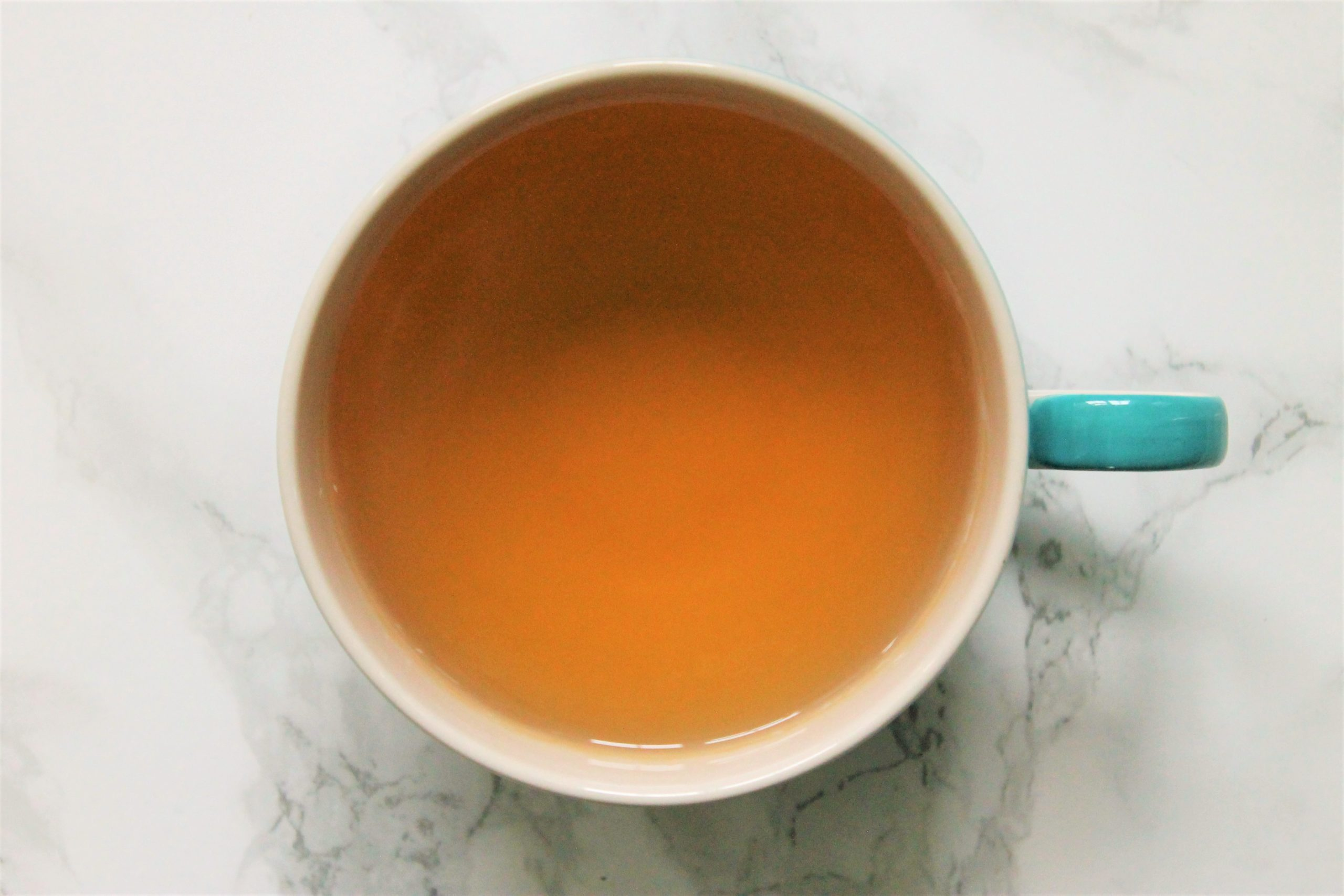 orange tea in teacup