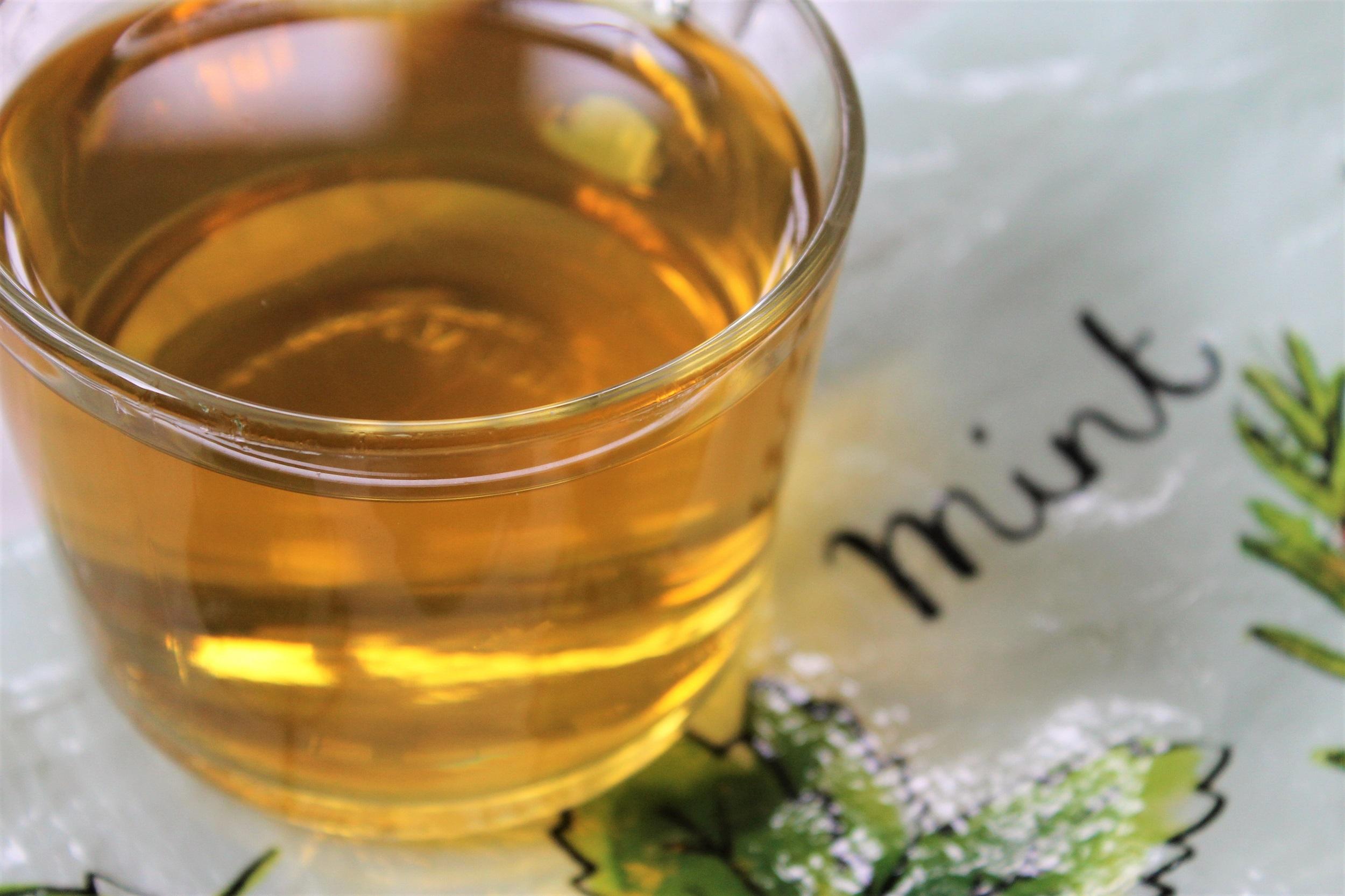 bion spearmint tisane in glass teacup
