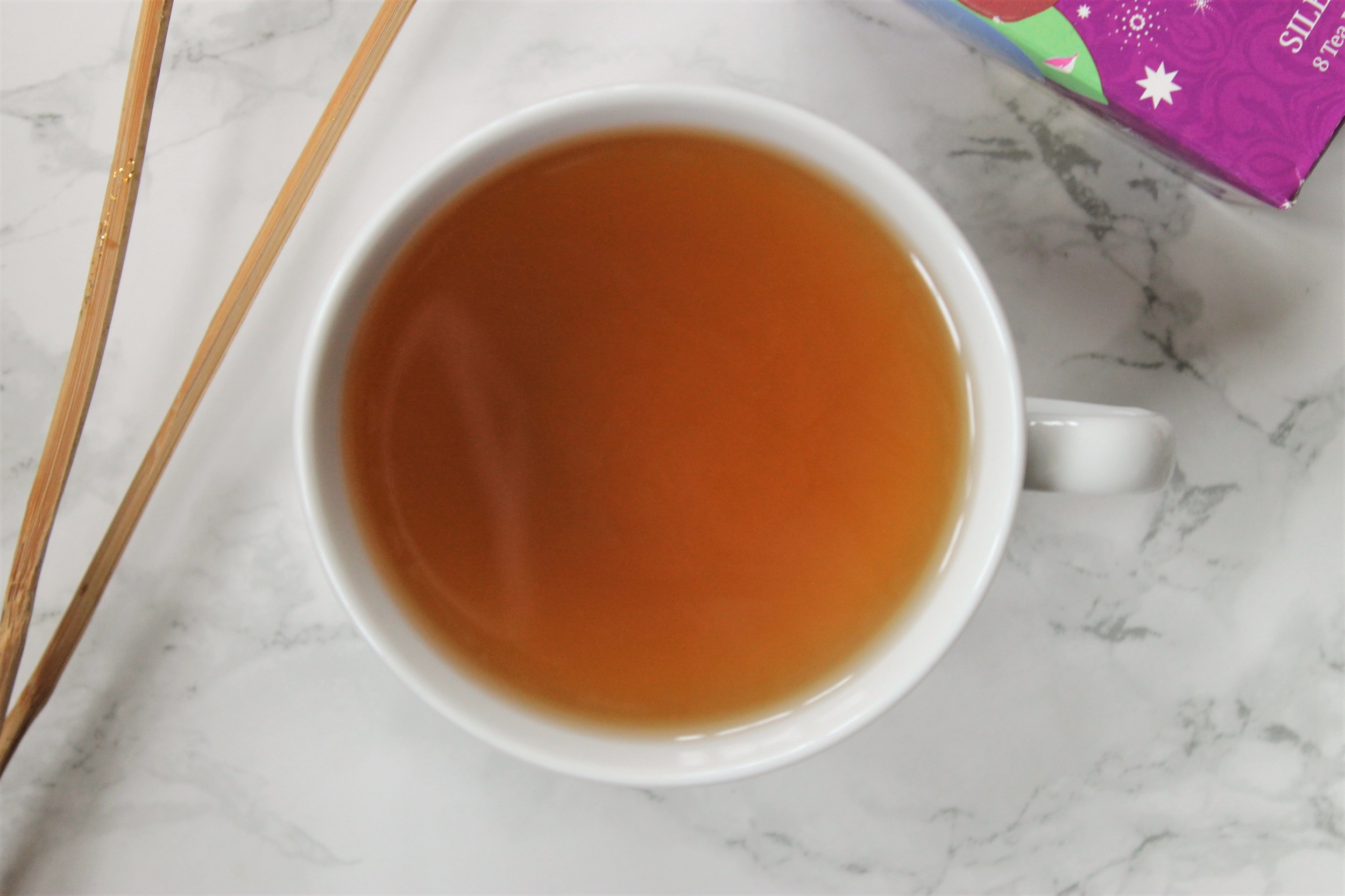 silent night tea in white porcelain teacup