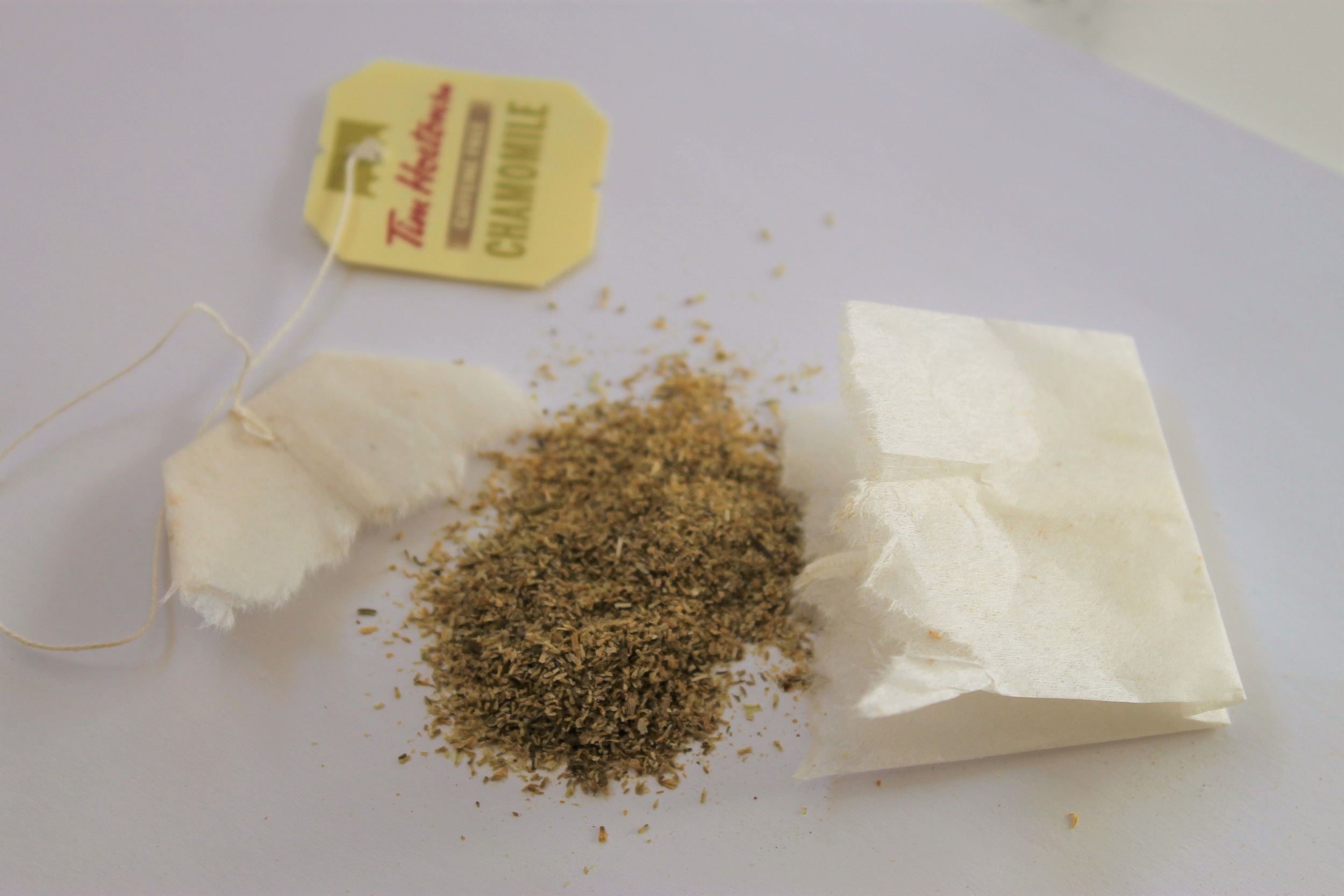 camomile flower petals from ripped teabag