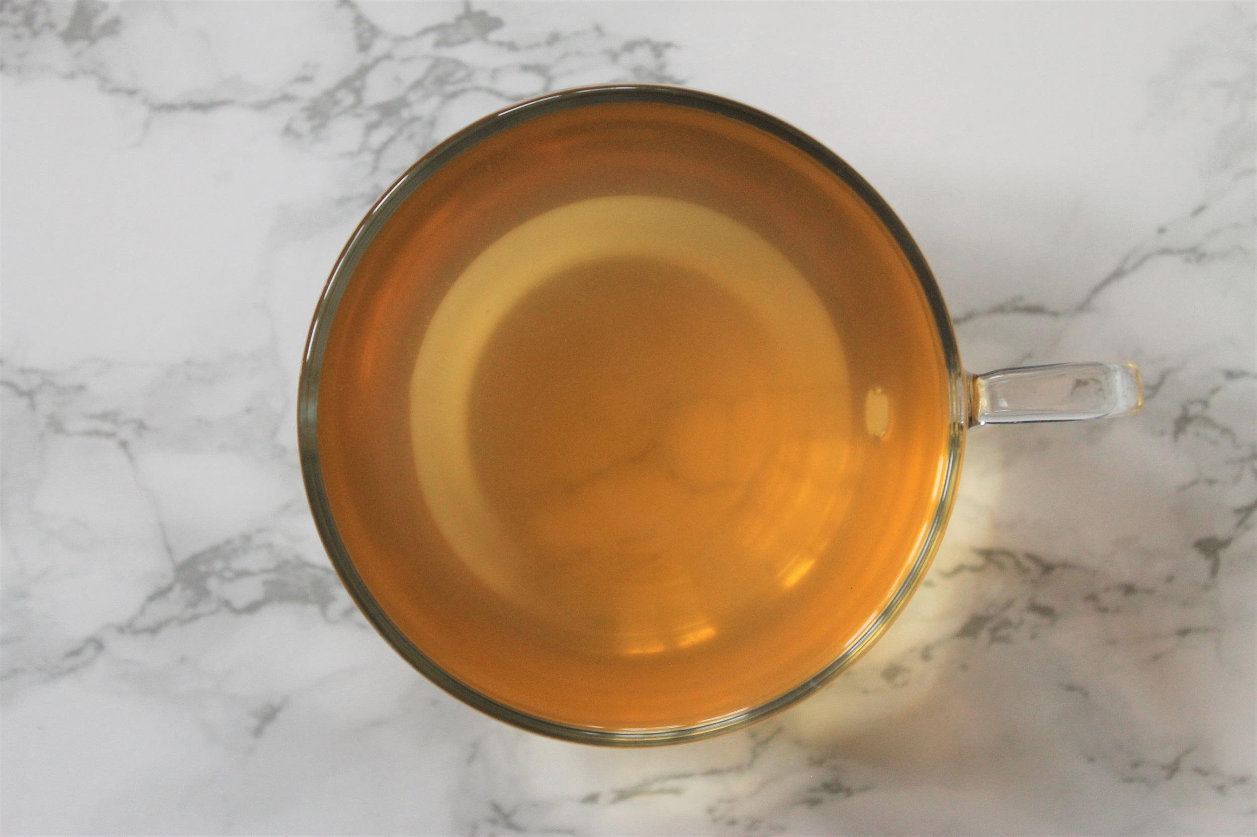 fresh apple tea in teacup