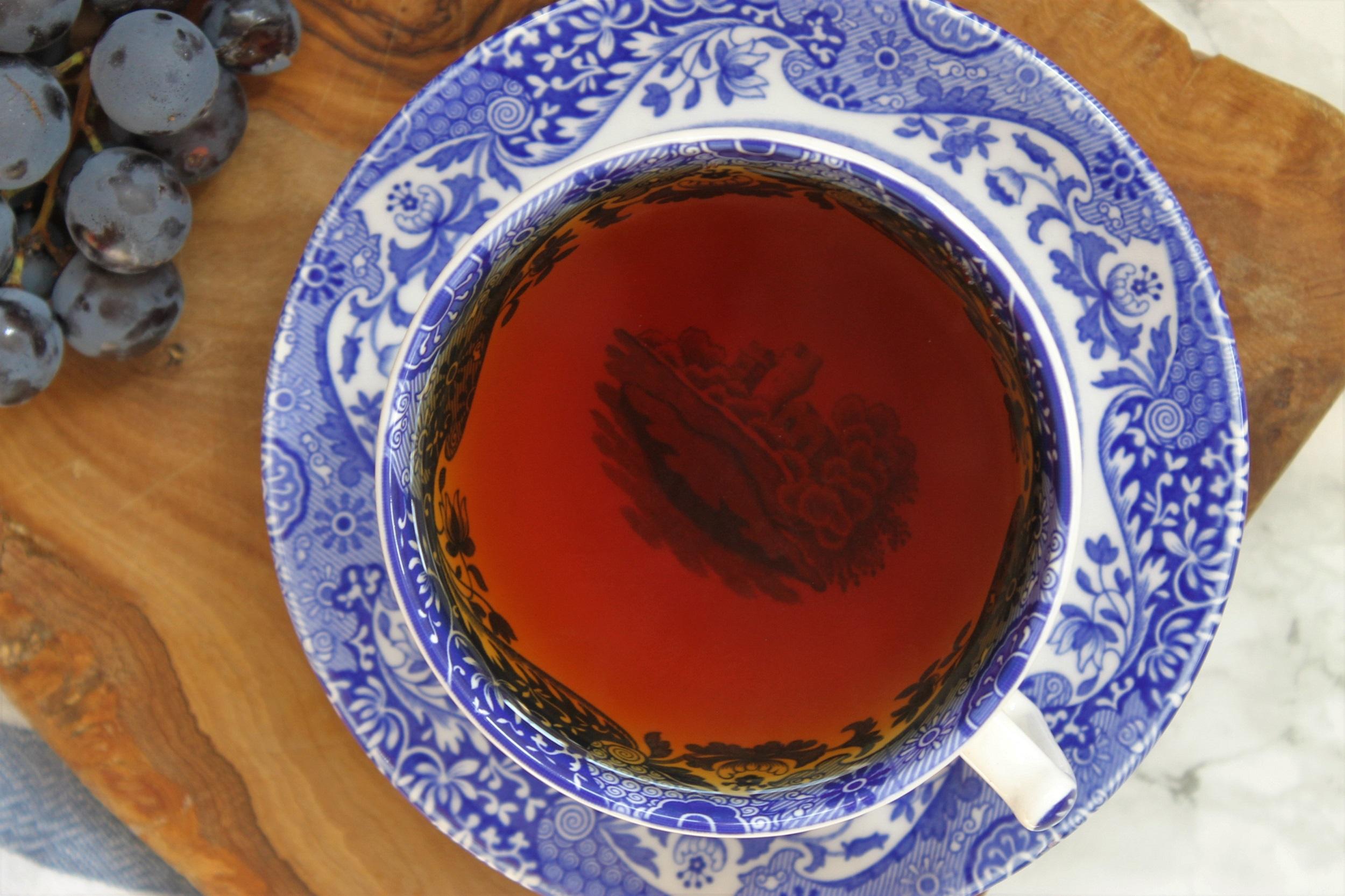 earl grey in willow pattern blue teacup
