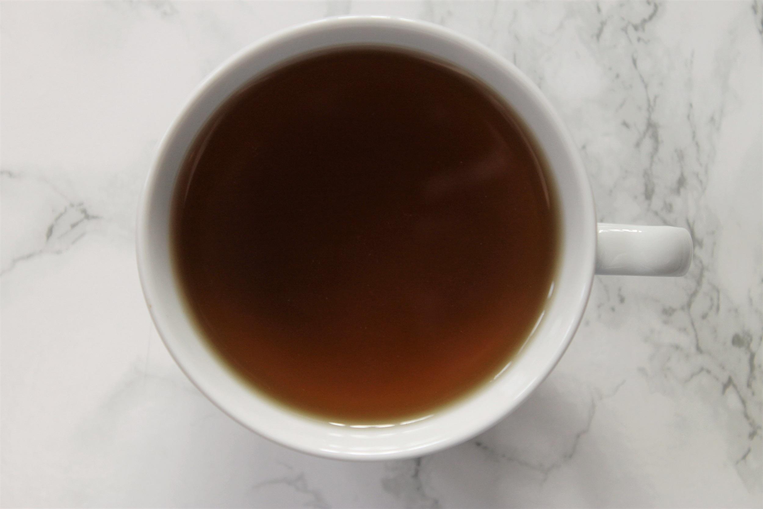peppermint herbal tea in white teacup