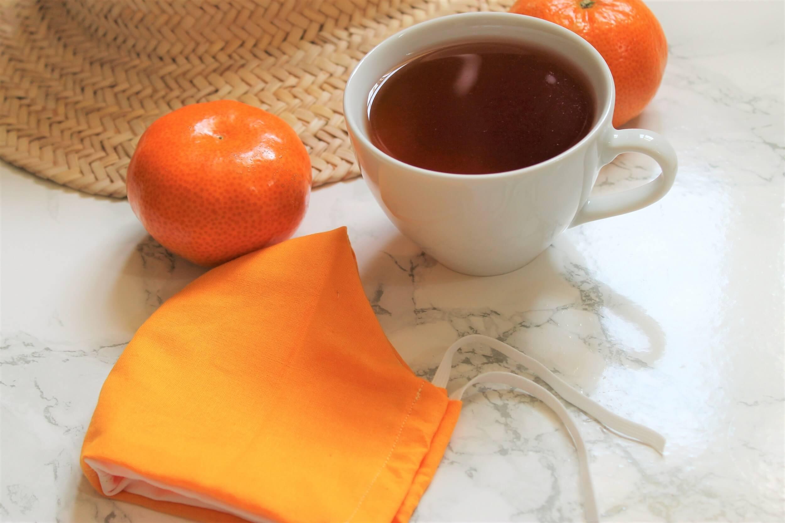 satsuma with orange tea in white teacup