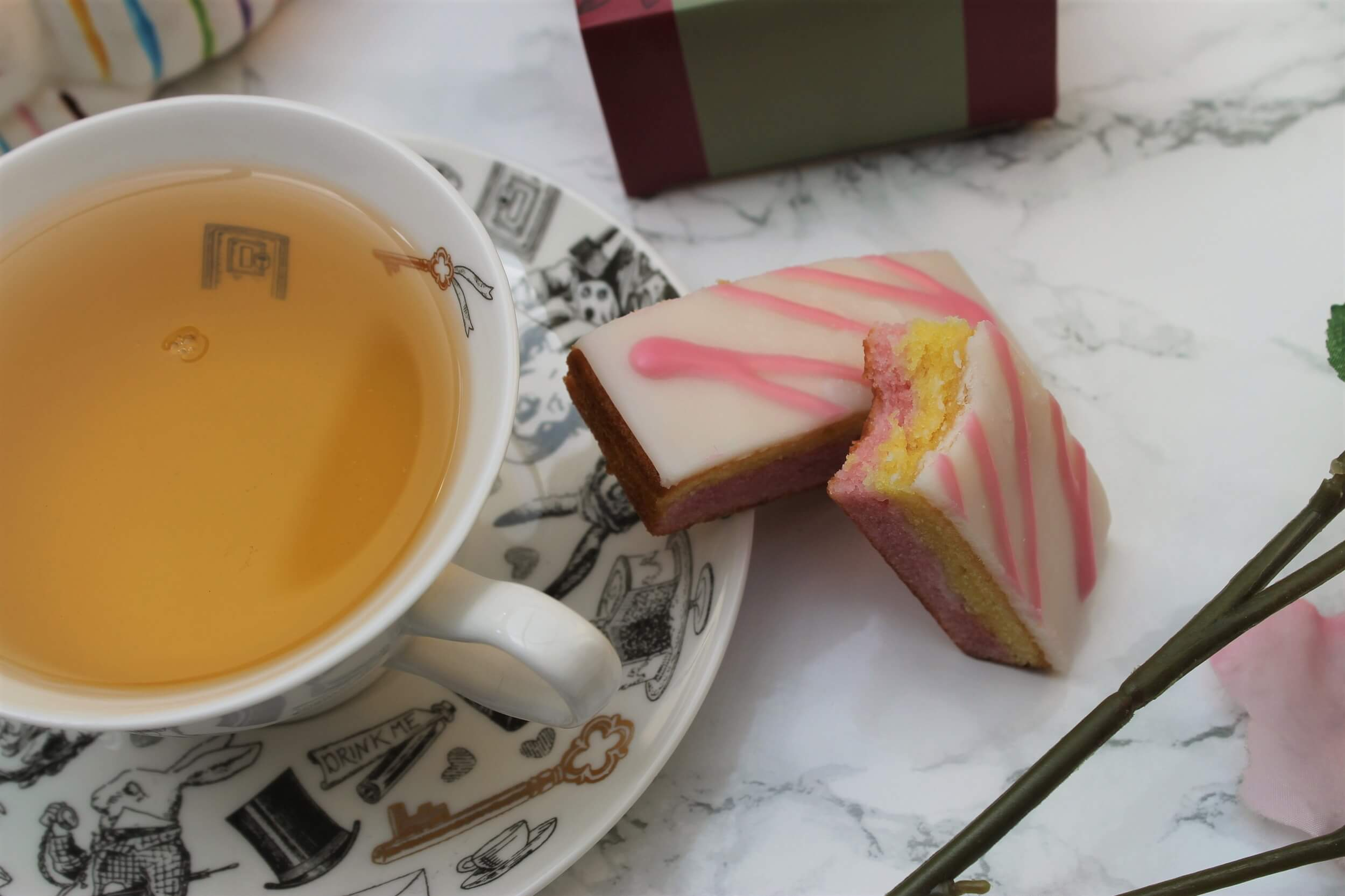 tea in a tea cup with angel cake slices