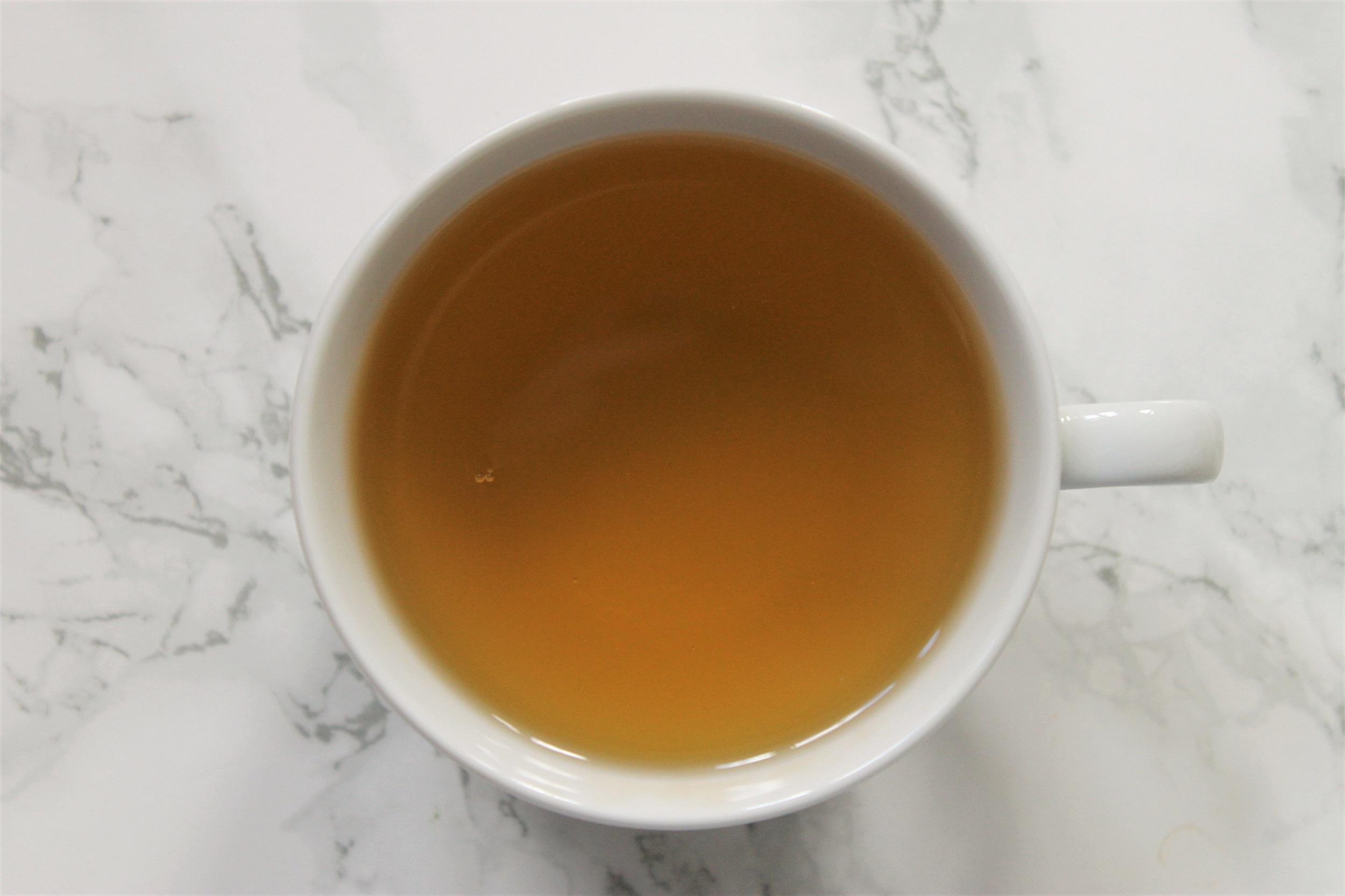 pure sri lanka green tea in teacup