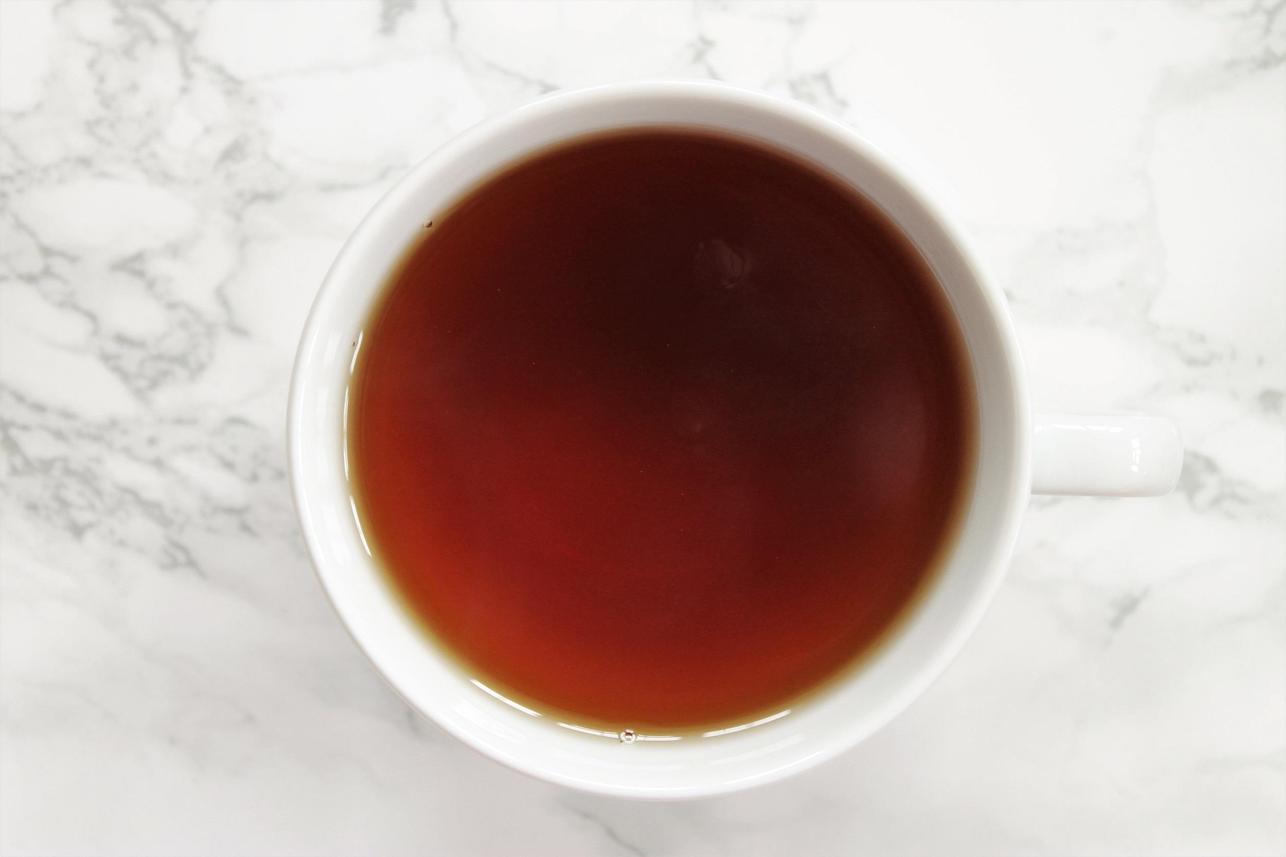 black tea in white teacup