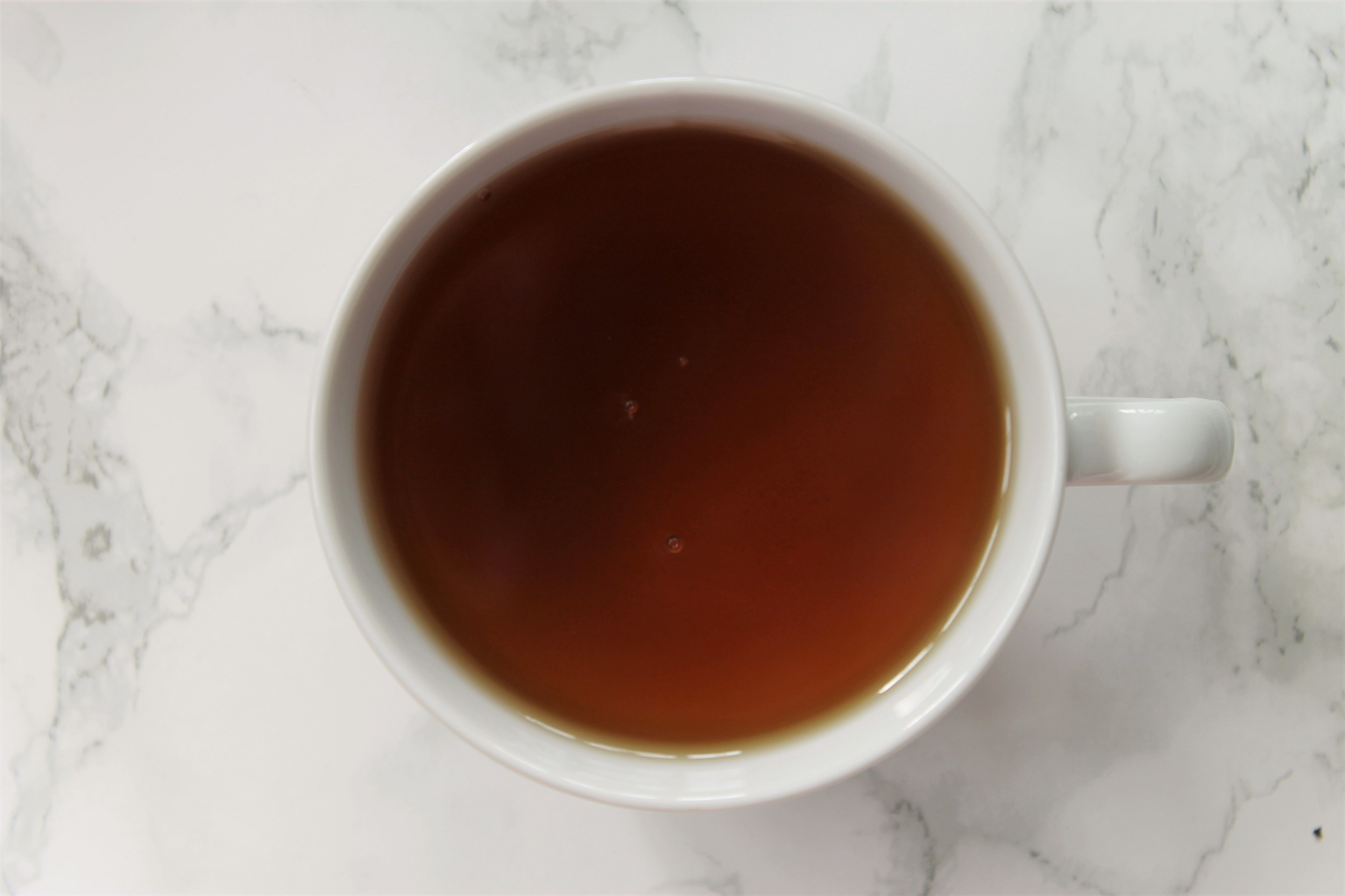 ceylon black tea in white teacup