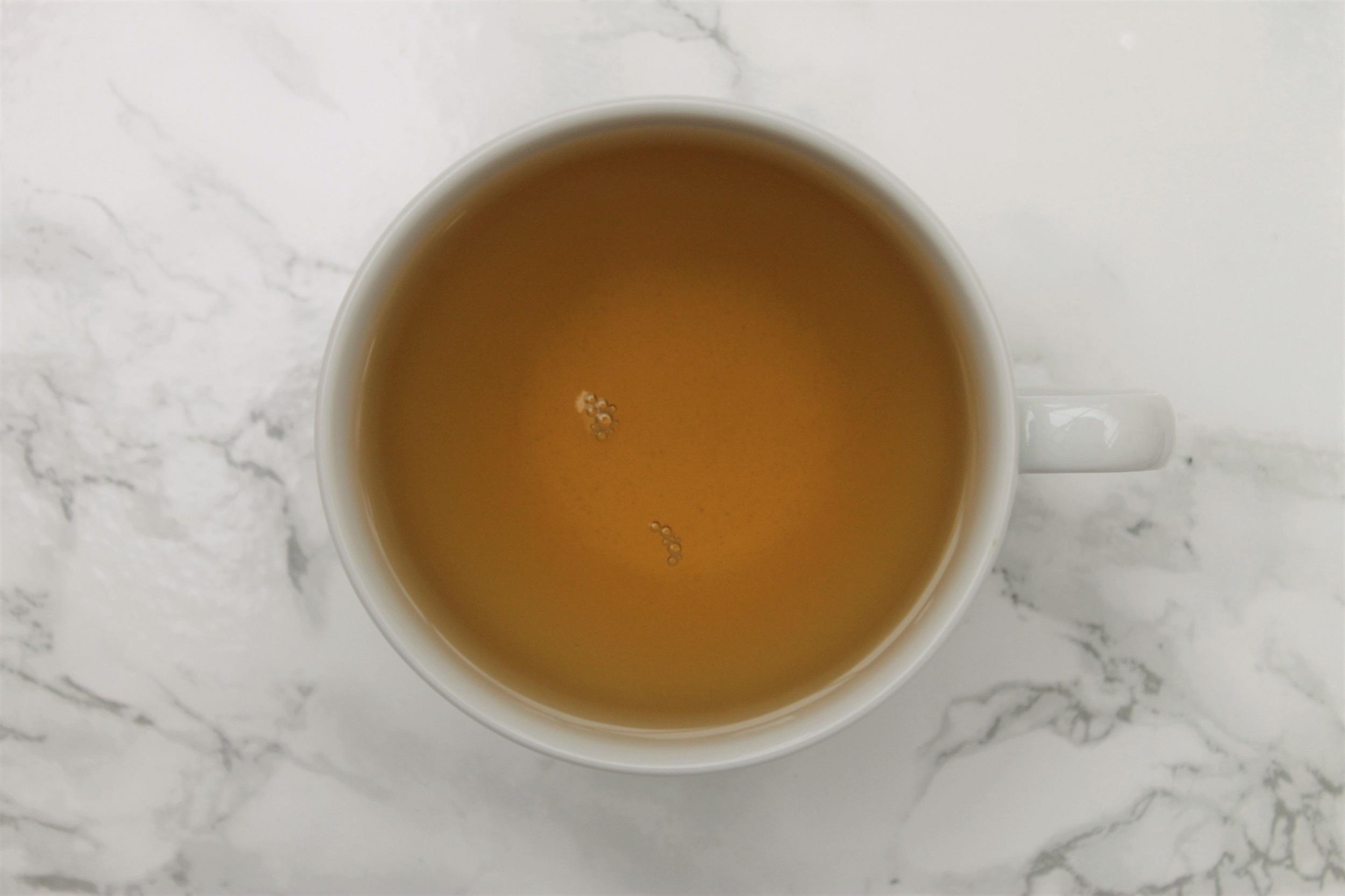 t2 sencha green tea in white teacup