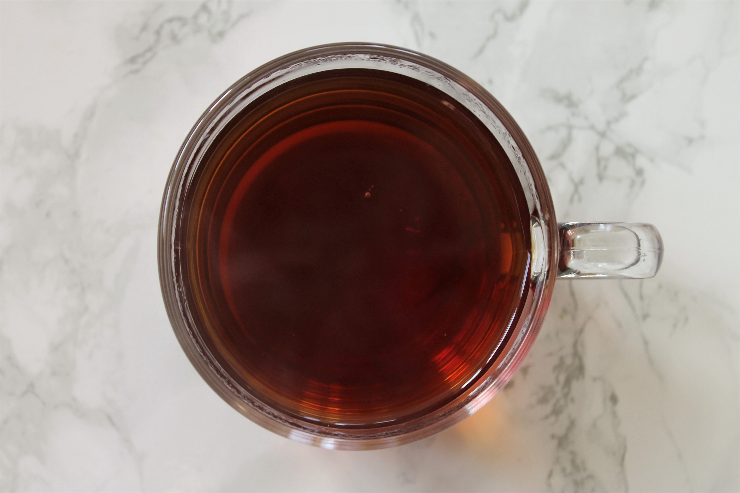 amber black tea in glass teacup