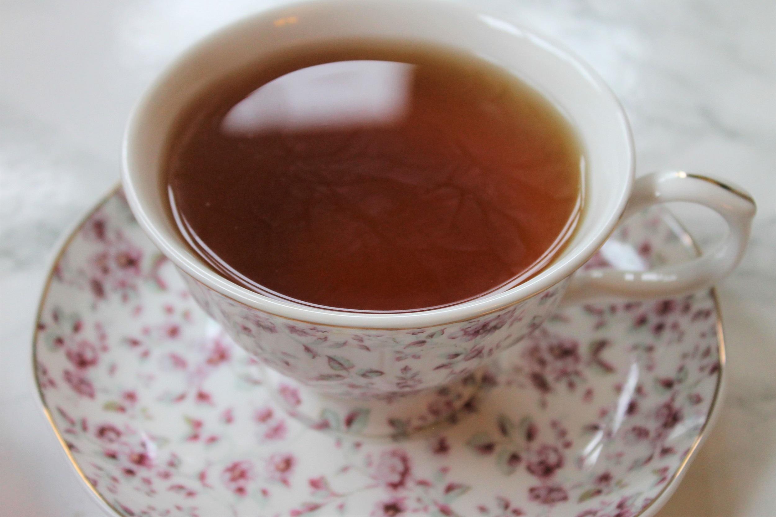 pink ditsy teacup with black tea