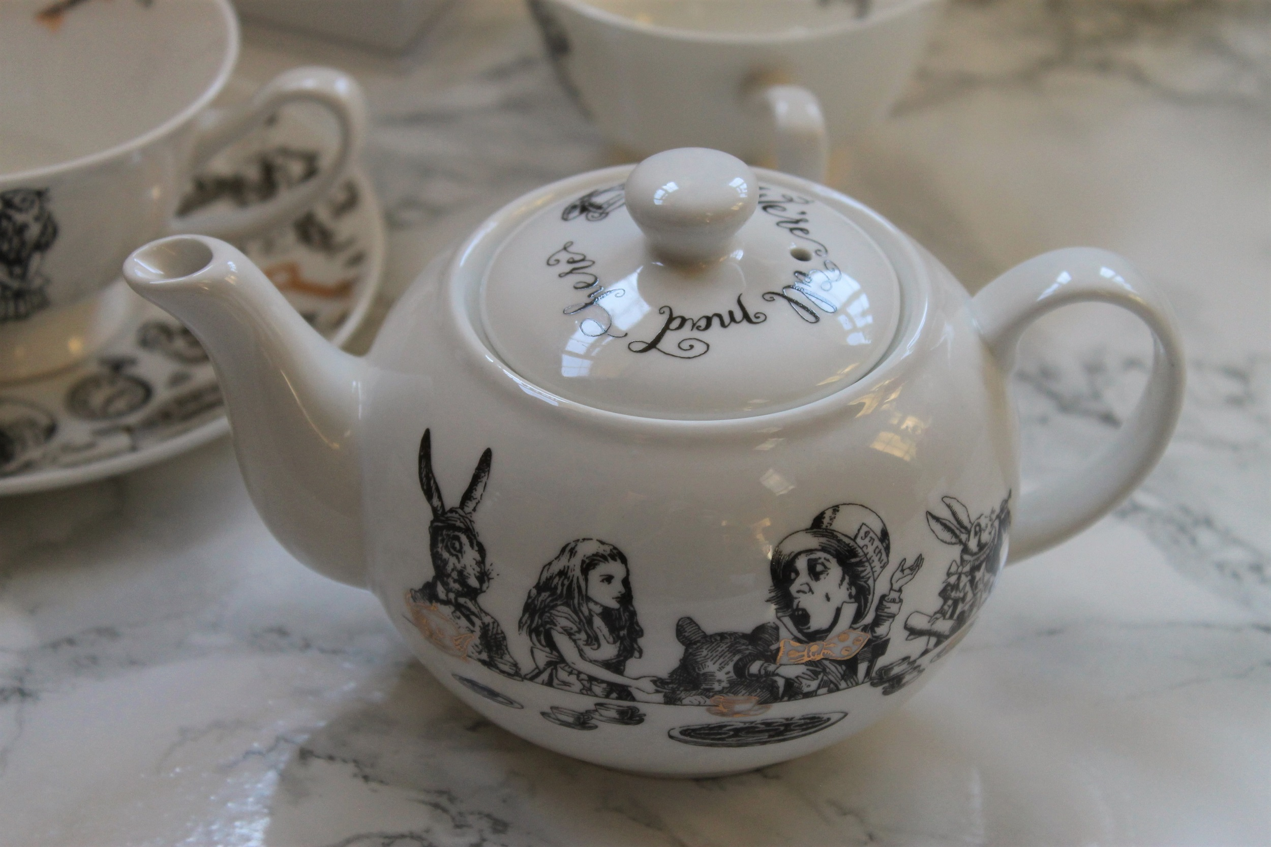 v and a mini teapot