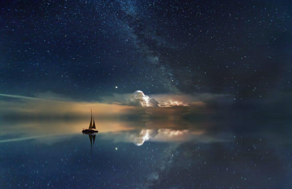 boat sailing on a dreamy lake