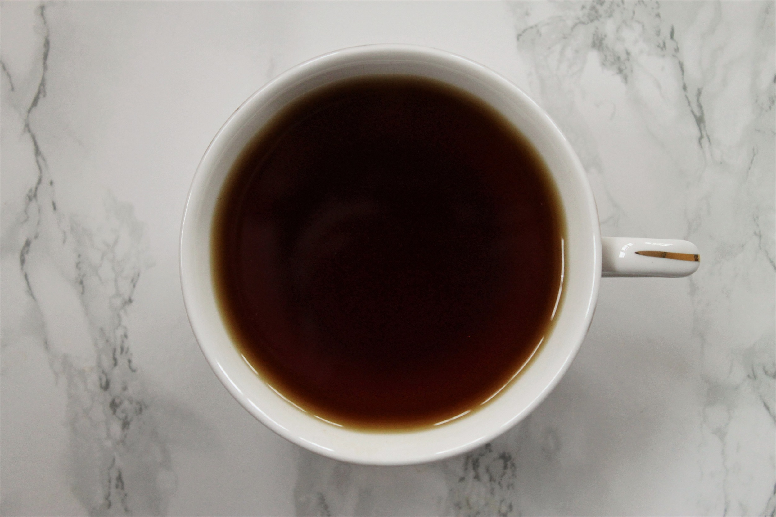 mlesna ceylon black tea in teacup from above
