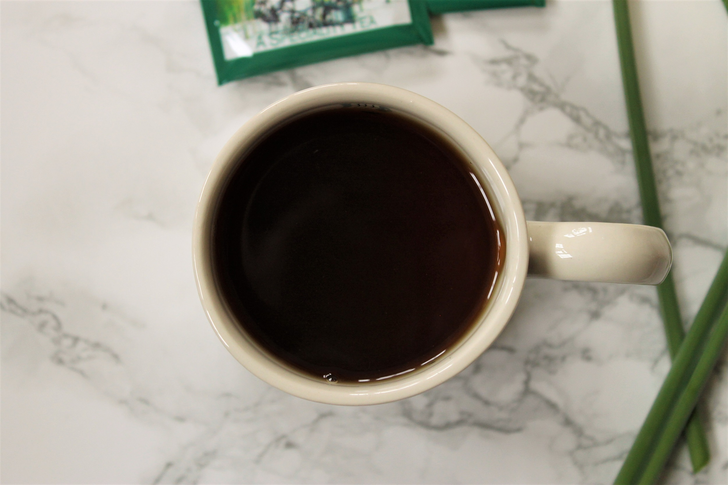 black maple tea in white mug