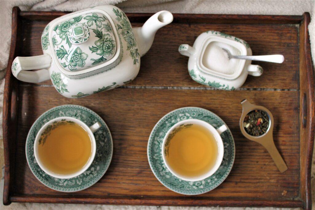 green china tea set with loose leaf tea