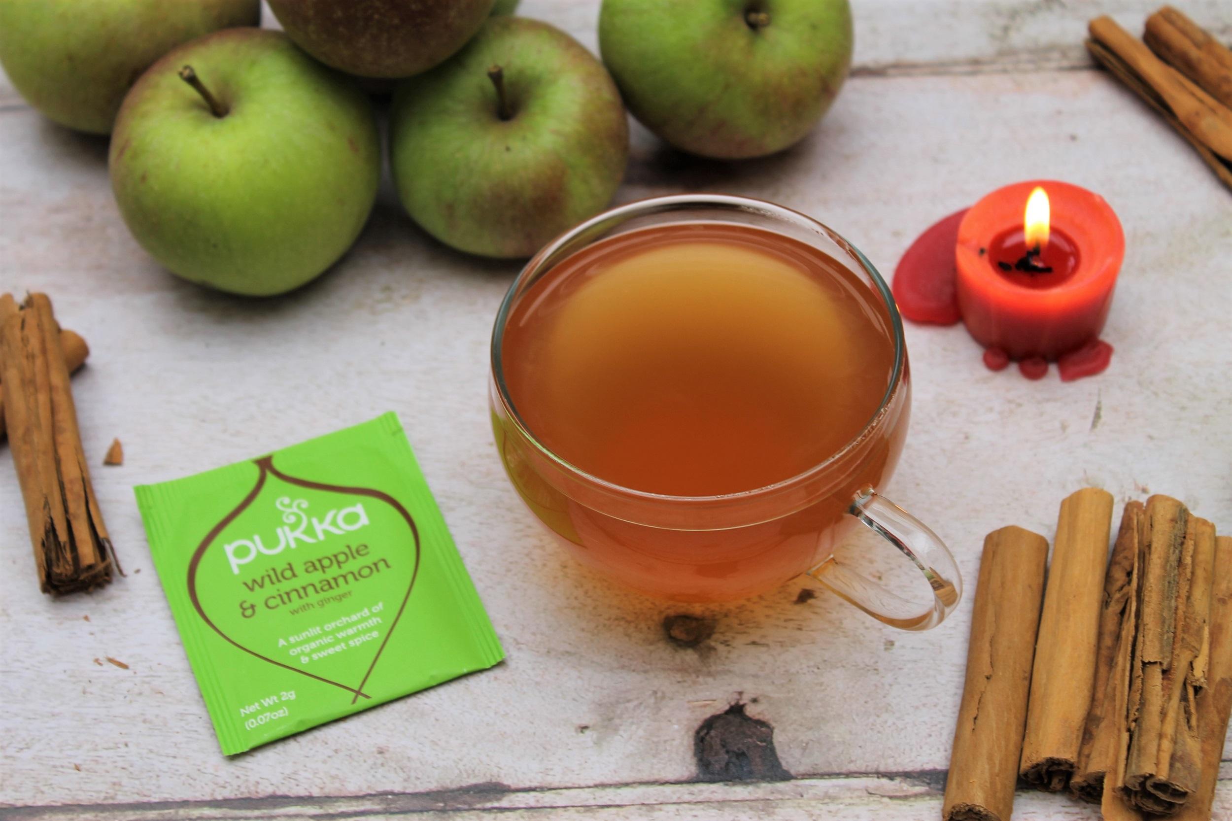 apple and cinnamon tea in teacup