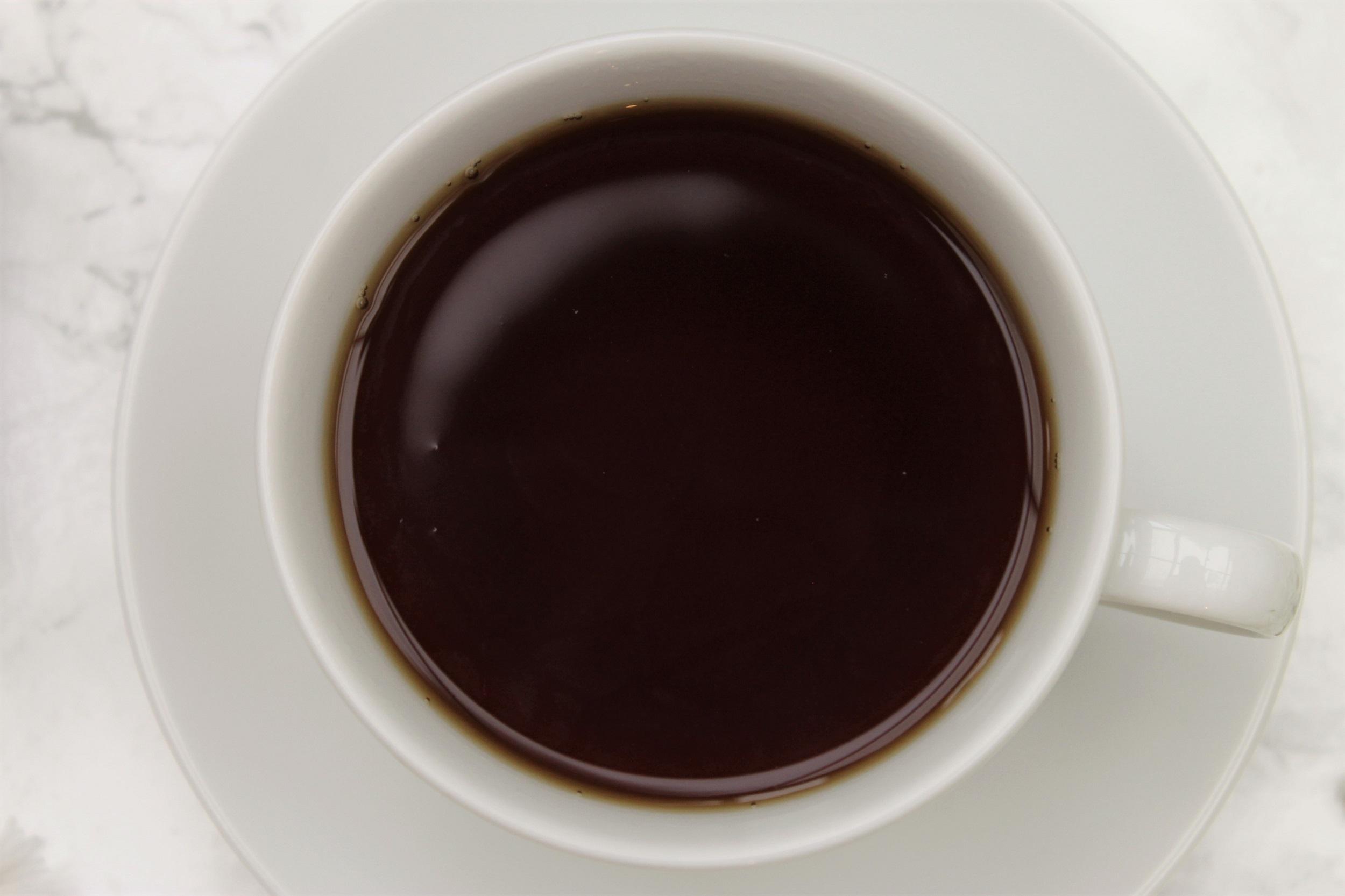 black afternoon tea in teacup